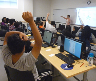 Attentive students in computer lab with instructor